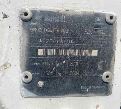 Мини багер Bobcat 320 image 9